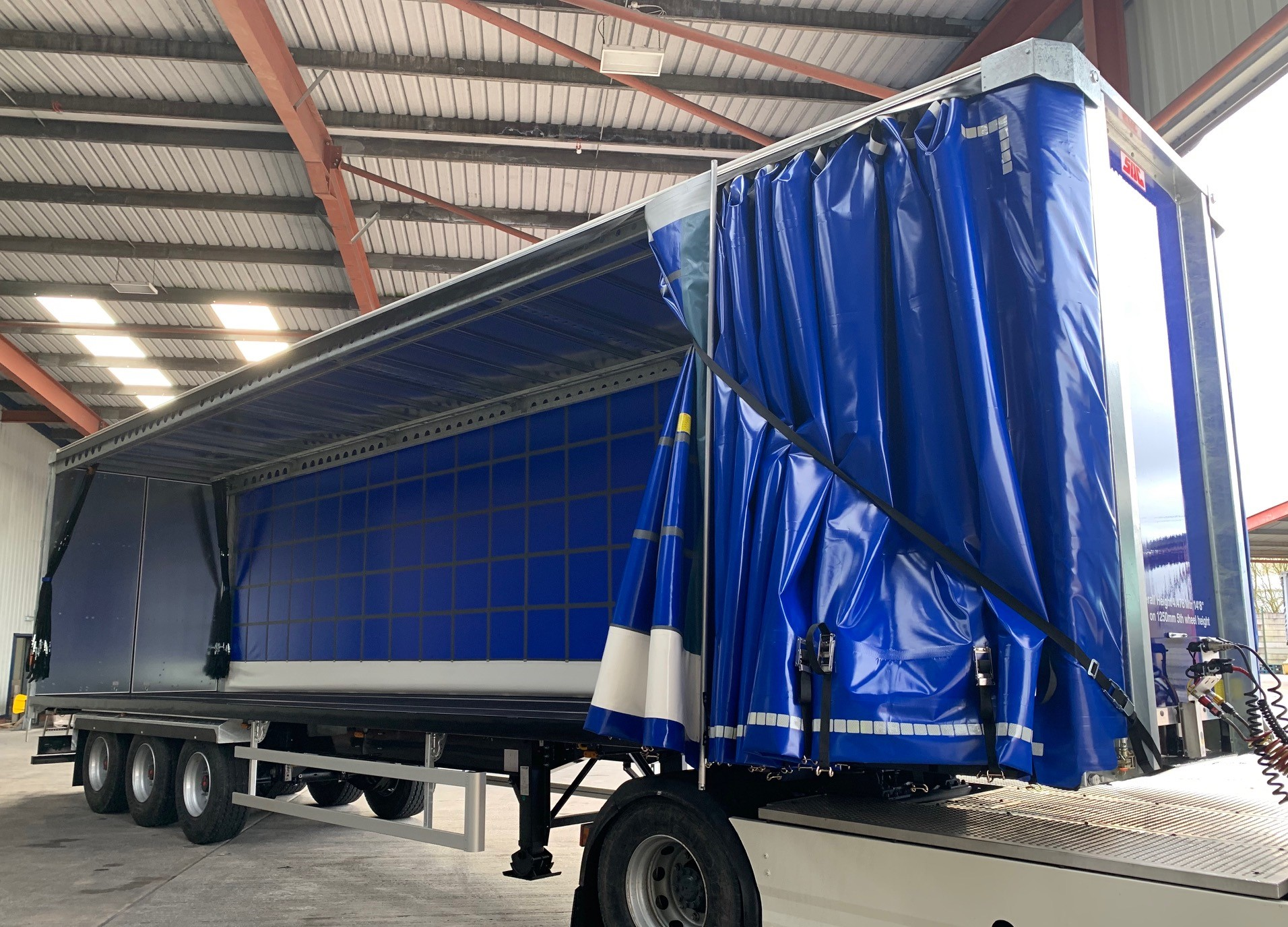 How to safely operate curtains on a curtain sided trailer